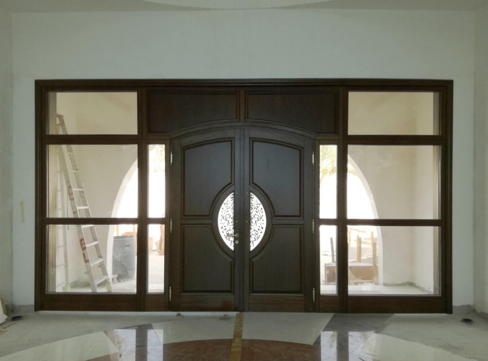 Fifteen special entrance doors installed in three luxury villas